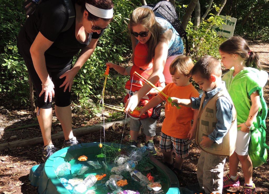 children pretend fishing in a kiddie pool