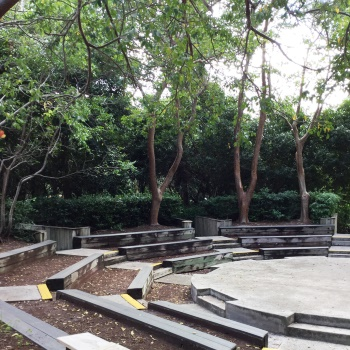 outdoor seating and stage surronded by trees